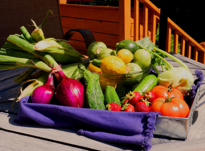Fruits and vegetables in basket on table