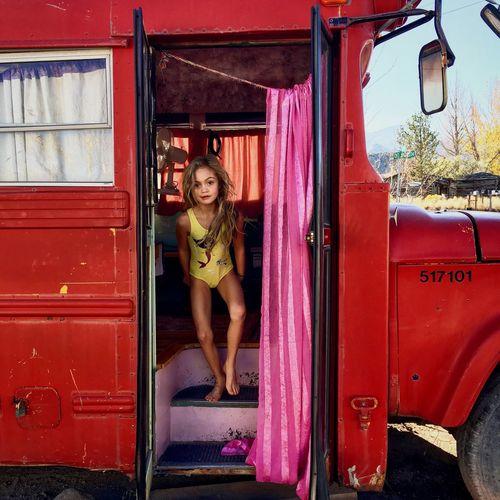 Portrait of girl standing in camper trailer