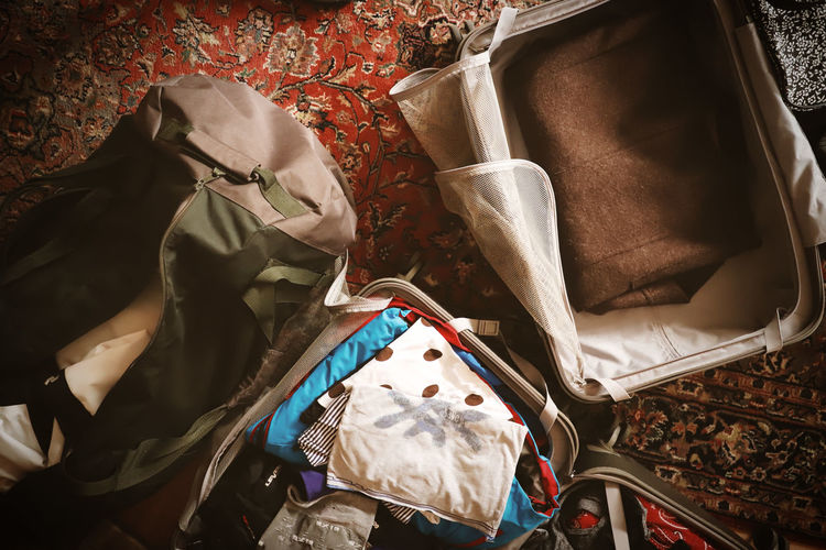 Luggage Holiday Traveling Travel Photography Bag Indoors  High Angle View No People Clothing Still Life Travel Textile Day Pattern Furniture Suitcase Human Representation Representation Floral Pattern Purse Sheet