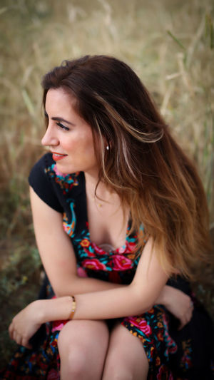 Beautiful Woman Beauty Brown Hair Casual Clothing Contemplation Focus On Foreground Hair Hairstyle Leisure Activity Lifestyles Long Hair Looking Looking Away One Person Portrait Real People Sitting Three Quarter Length Women Young Adult Young Women