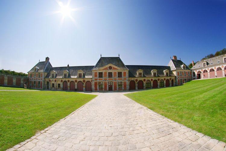 Chateau de vaux-le-vicomte against blue sky on sunny day