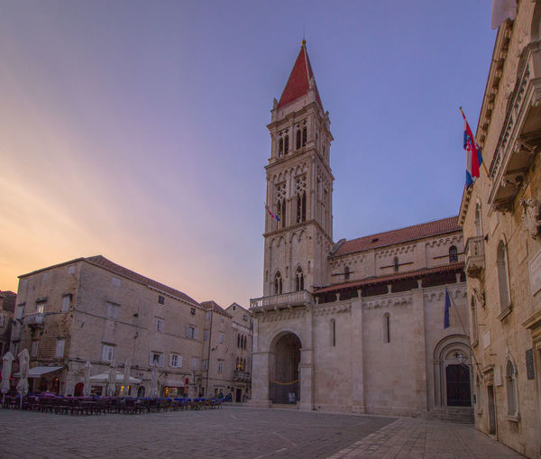 Low angle view of trogir cathedral against sky during sunset