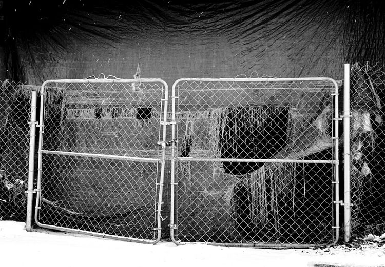 Metal Fence Tattered Tarp Chainlink