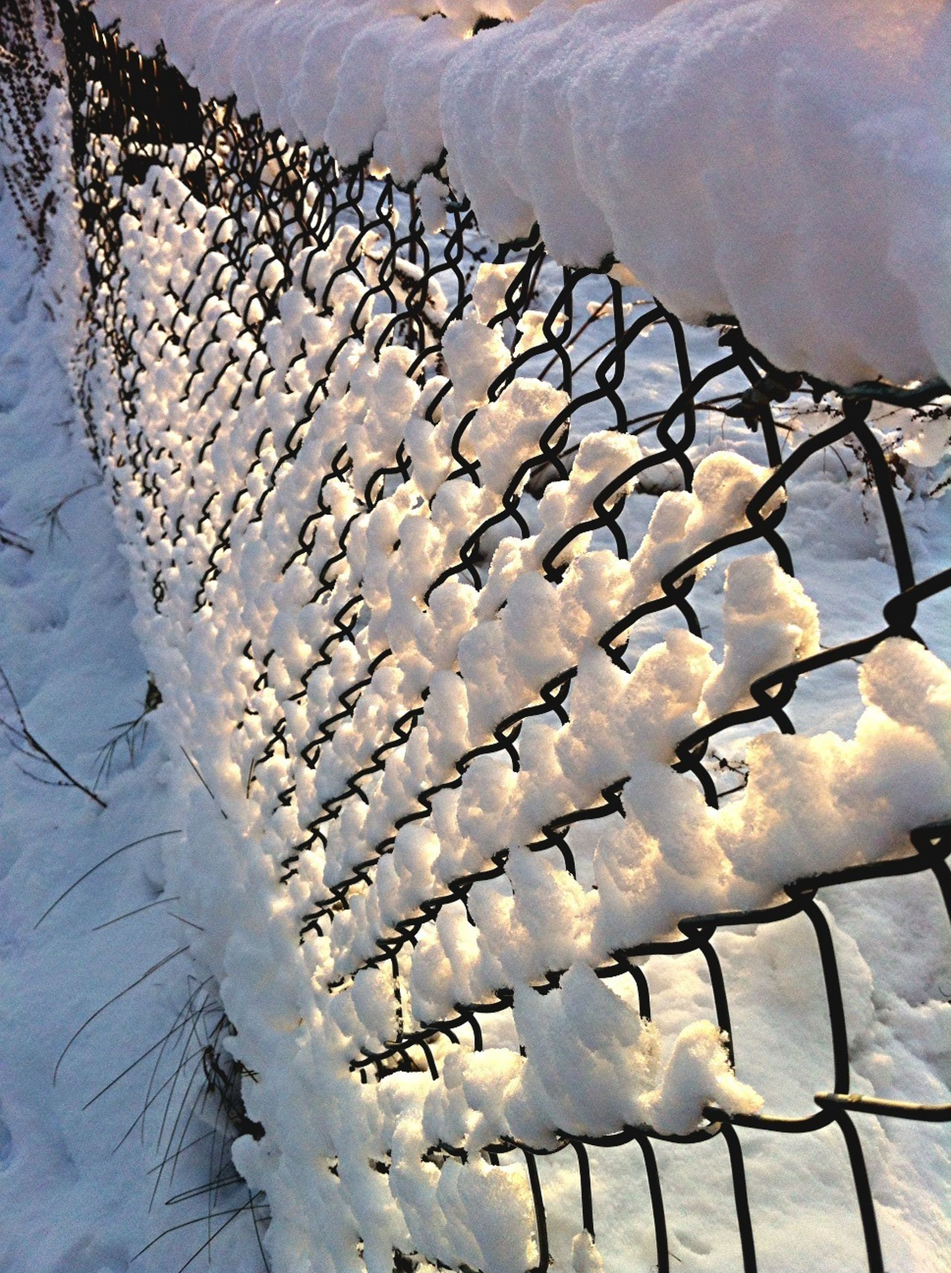snow, winter, cold temperature, fence, water, protection, metal, weather, sky, season, safety, pattern, day, built structure, nature, outdoors, no people, frozen, railing, architecture
