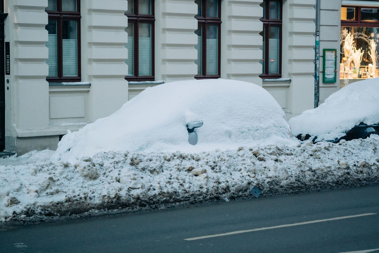 Car completely covered in snow