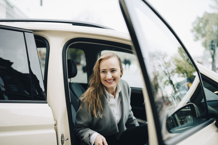 Portrait of a smiling young woman in car