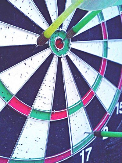 Winning in a game of darts Darts Board Games Playing Playing Games