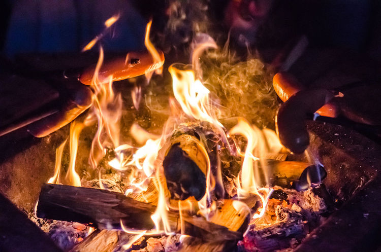 Campfire in the wild Bonfire Burning Campfire Close-up Cooking Fire Fire - Natural Phenomenon Fire Pit Flame Food Glowing Heat - Temperature Motion Night No People Outdoors Sausage Wood - Material