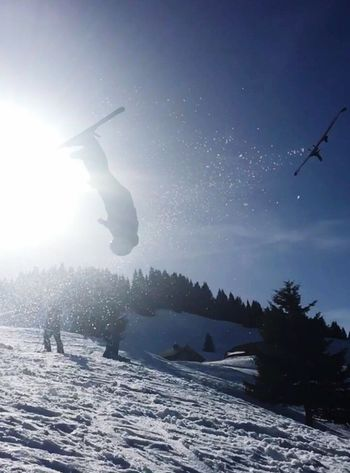 Ski backflip Full Length Mid-air One Person Snow Outdoors Upside Down Leisure Activity Nature Energetic Winter Motion Day Jumping Real People Sky Water Tree People