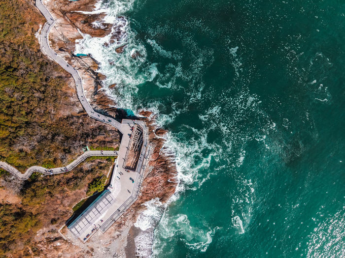 High angle view of road amidst sea