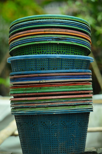 Close-up of multi colored stack on metal