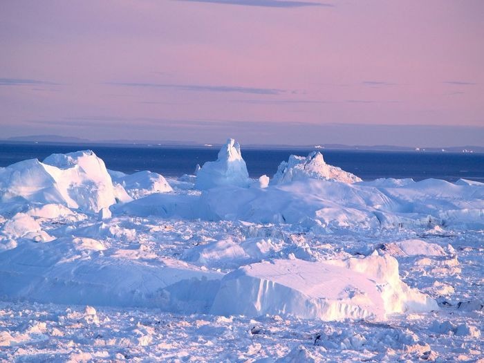 Scenic View Of Ice Berg Against Sky During Sunset