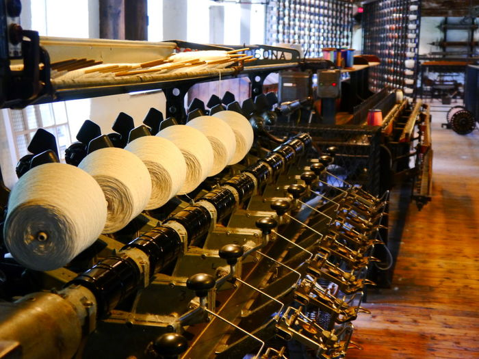 Quarry Bank Mill In A Row Large Group Of Objects Indoors  Drink Arrangement Wine Food And Drink Refreshment Abundance Business Wine Bottle Alcohol Bottle Focus On Foreground Food And Drink Industry No People Order Still Life Cellar Collection Winemaking