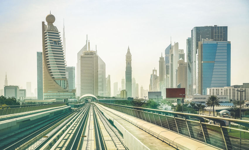 Dubai skyline and downtown skyscrapers from monorail platform railway - Modern architecture concept with highrise buildings on world famous metropolis in United Arab Emirates - Retro vintage filter Arab Arabic Architecture Background Building Business Center City Cityscape Commute Connect Construction Different Direction Downtown Dubai East Emirates Fast Go Holiday Horizontal Landmark Landscape Luxury Marina Metro Middle Modern Monorail  New Night Office Panorama Perspective Point Rail Skycraper Skyline Skyscraper Tourism Tower Train Transport Travel UAE United Urban View World
