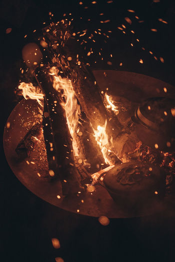 High angle view of fire in the dark