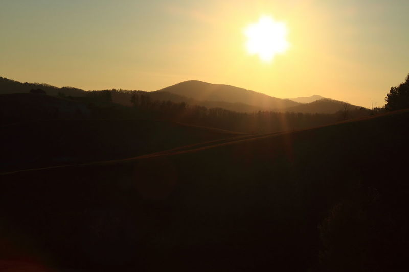 Blue Ridge Mountains Flares North Carolina Rolling Hills Beauty In Nature Blue Ridge Parkway Clear Sky Day Landscape Mountain Nature No People Outdoors Scenics Silhouette Sky Sun Sunlight Sunset Tranquil Scene Tranquility Tree