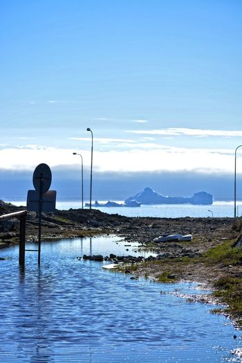 Ilulissat, Greenland, July | midnight sun | impressions of Jakobshavn | road sign - no tresspassing on a flooded road | icebergs in the Disko Bay in the background Day Outdoors Greenland Ilulissat Impression Scenery Iceberg Bay Beauty In Nature Tranquil Scene Tranquility Non-urban Scene Idyllic Leisure Activity Road Sign Flooded Road Scenics - Nature No Tresspassing Midnight Sun Sea Cloud - Sky Nature Water