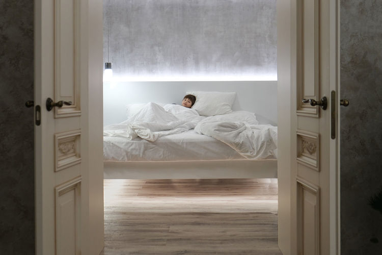 Man sleeping on bed at home