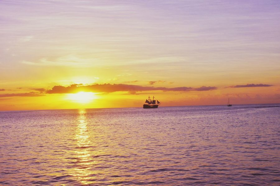 Sunset Sea Colors Travel Sea Water Scenics Tranquility Outdoors Nature Sky Nautical Vessel Horizon Horizon Over Water Beauty In Nature Reflection Day Sailing Cloud - Sky Landscape