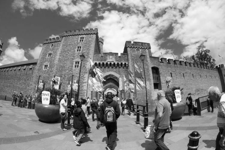 Entrance to Cardiff Castle during the Tafwyl festival Architecture Backpack Built Structure Castle City City Life Cloud Cloud - Sky Cloudy Day Headphones Large Group Of People Outdoors Sky Tourism Tourist