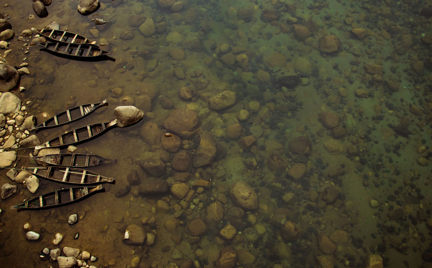 Abandoned Beauty In Nature Boats Dawki Day Full Frame High Angle View Lake Large Group Of Objects Meghalaya Nature No People Outdoors Reflection Rock Shallow Solid Tranquility Transparent Water Waterfront Wet