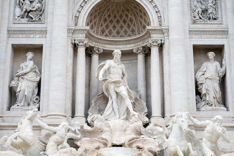 Fontana Di Trevi Trevi Fountain Architectural Column Architecture Art And Craft Day Female Likeness Human Representation Male Likeness Marble Memorial Monument No People Outdoors Sculpture Statue Tourism Travel Destinations