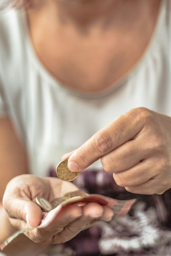 Close-Up Of Woman Holding Coins