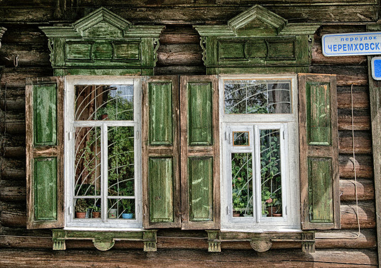 Window Wood - Material No People Glass - Material Day Built Structure Architecture Green Color Transparent Building House Building Exterior Outdoors Plant Door Nature Security Old Wall - Building Feature Safety Glass Window Frame