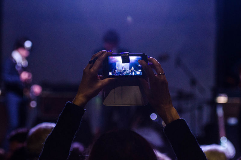 Woman Photographing At Concert Using Smart Phone