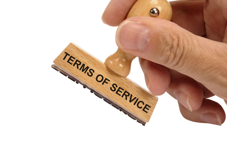 terms of service printed on rubber stamp in hand Business Legality Print Regulate Rules Statement Agreement Compliance Conditions Guidelines Human Hand Law Legal License Policy Privacy Regulations Rule Stamp Studio Shot Terms Terms And Conditions Terms Of Service Text White Background