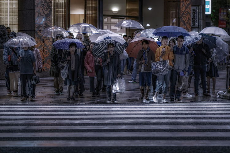 Japan Photography Tokyo Tokyo Street Photography Architecture City Crosswalk Crowd Day Group Of People Large Group Of People Men Outdoors Protection Rain Rainy Season Real People Road Marking Street Street Photography Streetphotography Umbrella Wet Zebra Crossing