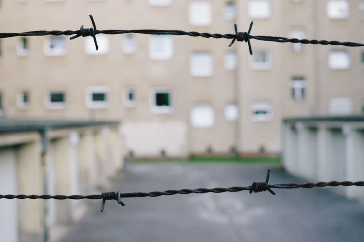 Close-up of barbed wire against sky
