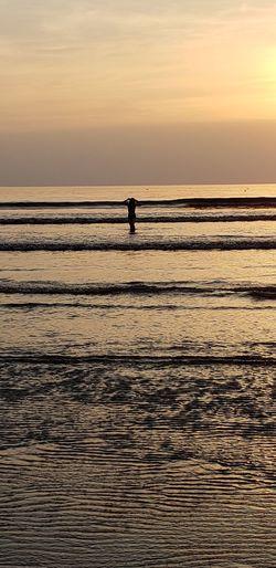 Water Sea Sunset Beach Full Length Healthy Lifestyle Silhouette Sport Standing Sunlight