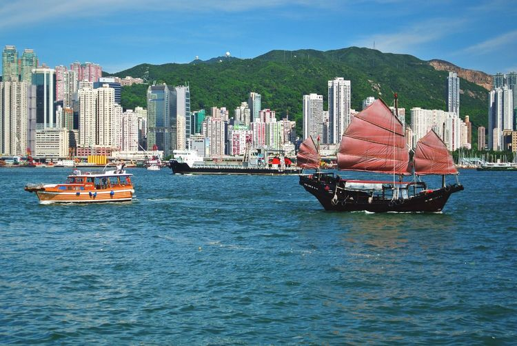 HongKong Hong Kong Hong Kong Skyline Hong Kong Victoria Harbour Hong Kong Architecture Hong Kong Building Hong Kong Skyscraper Boats Boats On Water Boats And Water Water Reflection Sail Chinese Boat Chinese Sailing Peaceful Calm Quiet Waves EyeEm Best Shots Hk Hong Kong Harbour Red Sail Red Sailboat Landscapes With WhiteWall Let's Go. Together.