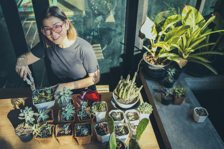 High angle portrait of woman planting