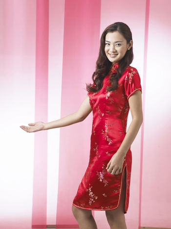 chinese woman wearing red cheongsam Red Happiness Laughing Tradition Traditional Clothing Woman Chinese Chinese New Year Cultural Festival Gong Xi Fa Chai Lifestyles Long Hair Oriental Style Qipao Smile Traditional Costume Wearing