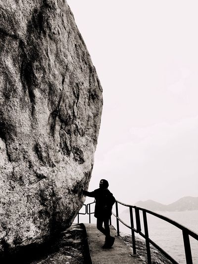 Full Length Hiking Hikingadventures Hiking Trail HongKong Hong Kong Cheung Chau Standing Railing Walking Leisure Activity Rear View Rock Formation Lifestyles Tranquil Scene Tranquility Solitude Scenics Cliff Sea Water Day Non-urban Scene Tourism Outdoors