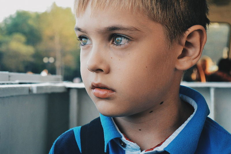 Close-Up Of Thoughtful Boy Looking Away At Restaurant