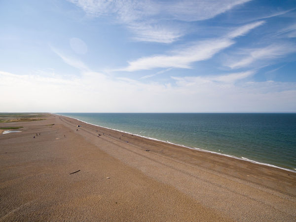 Norfolk coastline beach front deserted Aerial Photography Beach Blue Sky And White Clouds Coastline Landscape Day Drone  Grass Area Horizon Over Water No People Norfolk Uk Outdoors Sea Sky Stones Pebbles Summertime