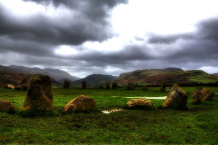 In the circle Beauty In Nature Cloud - Sky Day Environment Field Grass Land Landscape Mountain Nature No People Non-urban Scene Outdoors Overcast Plant Scenics - Nature Sky Stone Circle Stone Circle Religous Landscape Storm Tranquil Scene Tranquility