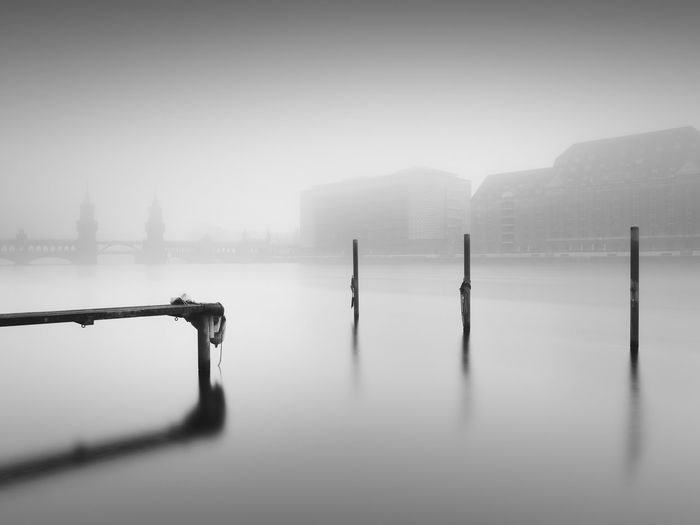 Wooden Posts In Spree River During Foggy Weather