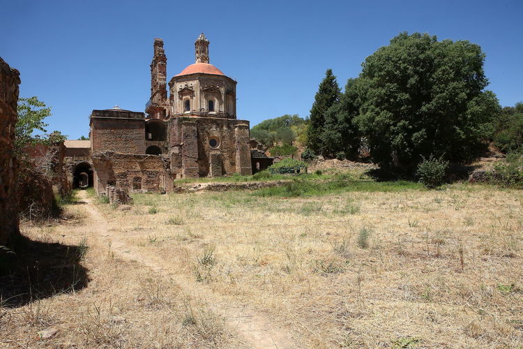 Old ruins of building against clear sky
