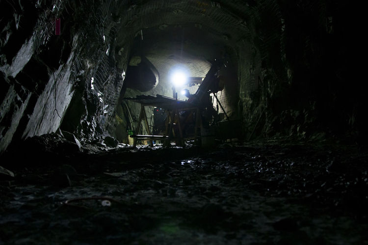 Illuminated tunnel in cave