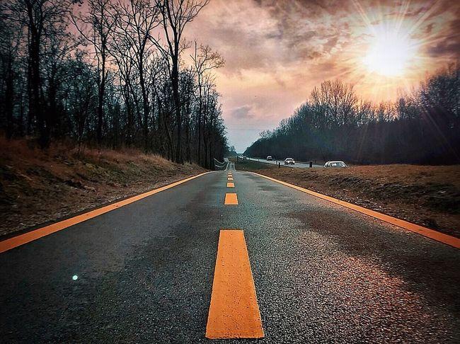 The Way Forward Road Marking Road Asphalt Transportation Tree Outdoors No People Sky Day