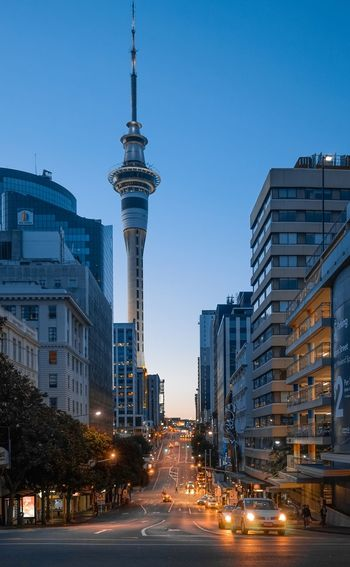 auckland tower TV Tower Orange Color Auckland, New Zealand Newzealand Sky Lines Architecture Building Exterior City Skyscraper Built Structure Clear Sky Illuminated City Life Cityscape Blue No People Night Sky Modern Low Angle View EyeEmNewHere EyeEmNewHere Stories From The City