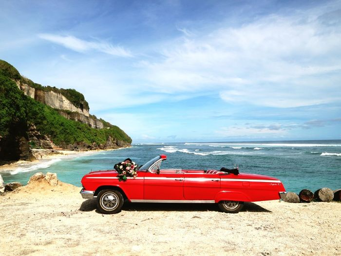 Classy Red Sea Beach Sand Nature Sky Car Red Vacations Transportation Outdoors Landscape Water Travel Destinations Day Beauty In Nature Cliff Cloud - Sky Horizon Over Water