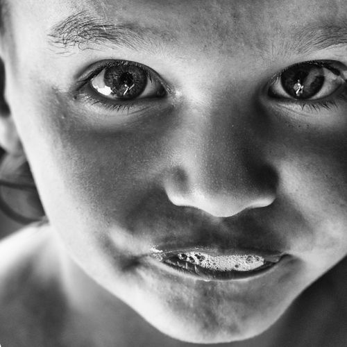 Close Kids Of EyeEm Authentic Moments Children Children's Portraits Fun Kids Kids Being Kids Portraits Authentic Child Childhood Close-up Detail Emotion Eyebrow Eyes Front View Girl Grimace Headshot Human Face Kid Looking At Camera Monochrome Portrait Spittle EyeEmNewHere The Portraitist - 2018 EyeEm Awards
