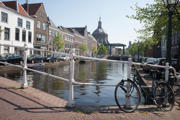 Leiden cityscape with bicycle Built Structure Architecture Building Exterior Water Building Bicycle Transportation Mode Of Transportation City Nature Day Canal Land Vehicle Sky Railing Bridge Travel Outdoors No People