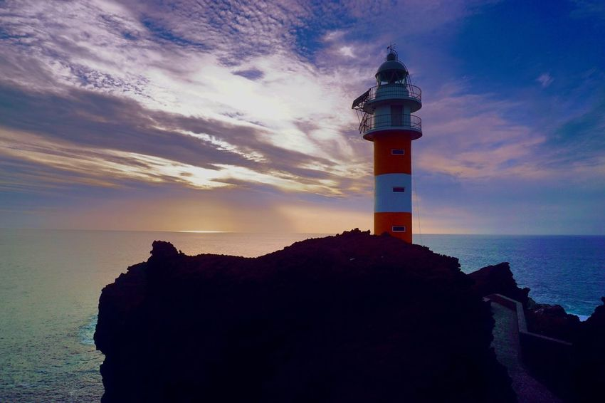 Tenerife, Canary Islands Lighthouse Guidance Sea Safety Sunset Sky Protection Direction Horizon Over Water Rock - Object Building Exterior Nature Beauty In Nature No People Built Structure Cloud - Sky Architecture Scenics Tranquility Water