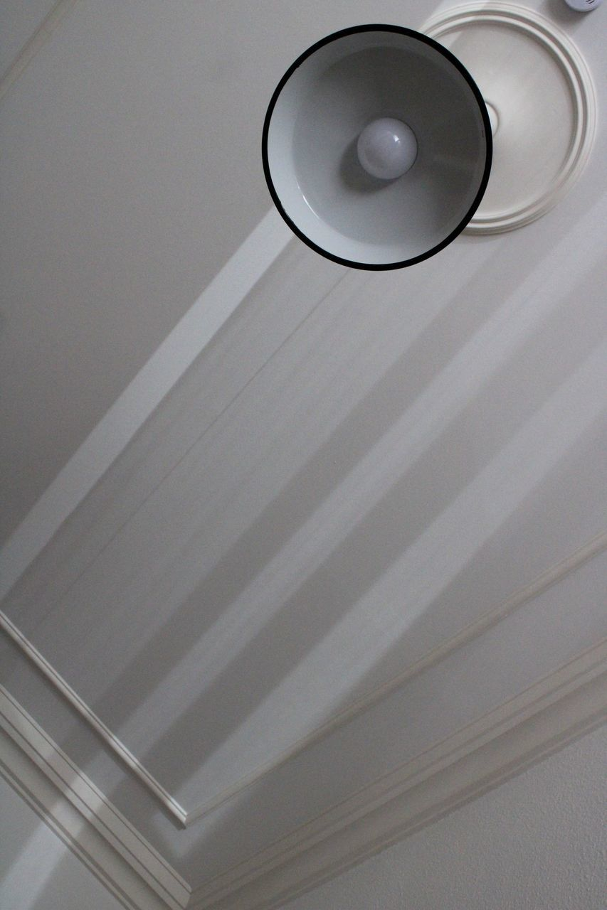 LOW ANGLE VIEW OF LIGHT BULB ON CEILING